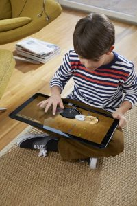 Boy Using XPS 18 Portable AIO on Floor