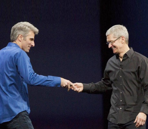 Apple-CEO-Tim-Cook-R-welcomes-Craig-Federighi-vice-president-of-Software-Engineering-on-stage-during-a-keynote-address-during-the-2013-Apple-WWDC-at-the-Moscone-Center-on-June-10-2013
