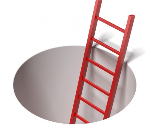 Ladder standing inside hole