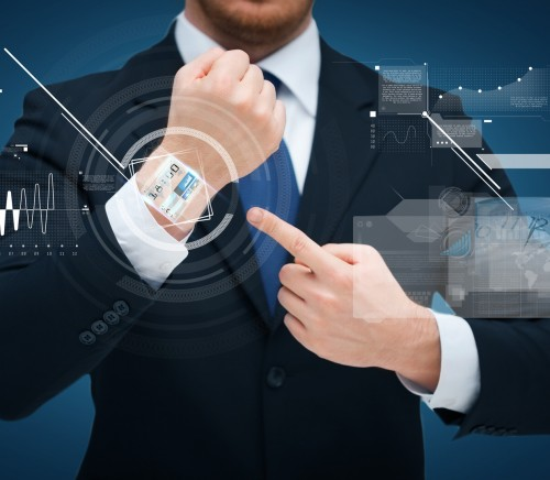 businessman pointing to something at his hand