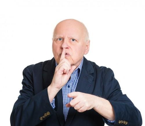 Shush. Portrait senior man gesturing keep quiet, finger on lips
