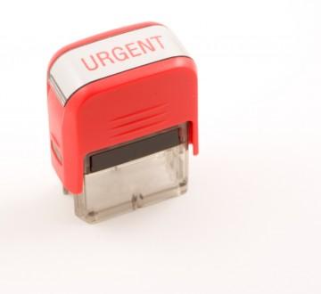 red urgent ink stamper