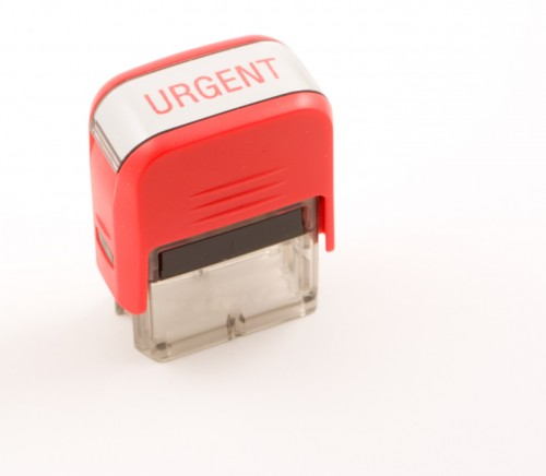 red urgent ink stamper