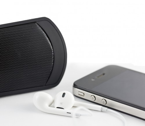 White Earphone , woofer and Smartphone equipment set isolated on