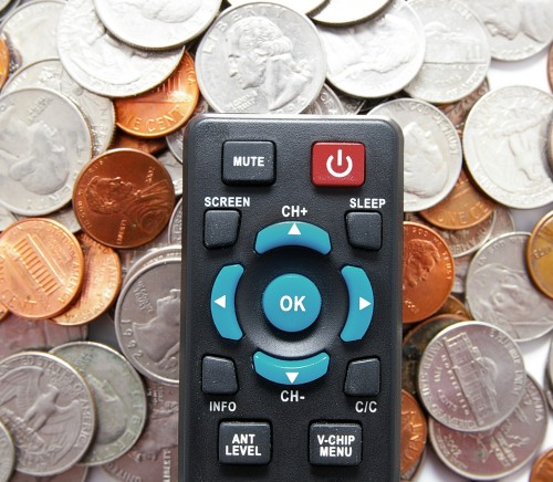 tv remote control and pile of coins