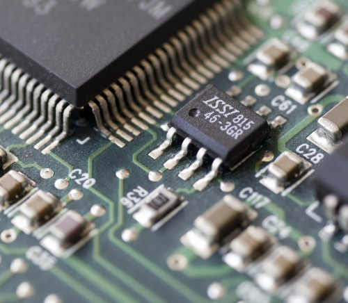 Closeup of a printed circuit board with components such as integrated circuits