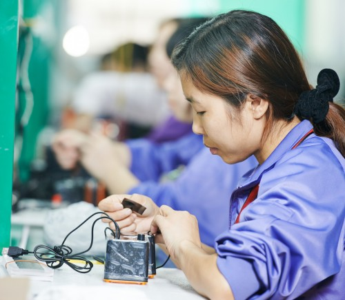 chinese worker assembling production at line conveyor in china factory