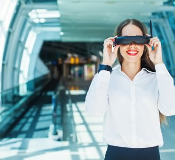 woman wearing goggles in futuristic interior - futuristic wearab