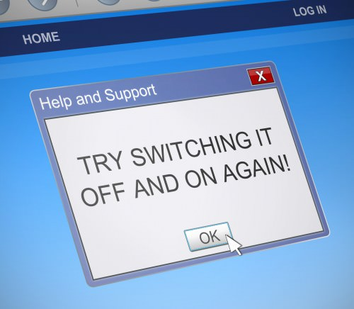 Illustration depicting a computer dialog box with a switch it off and on again message concept.