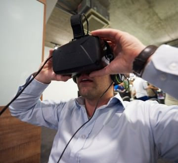 young man using virtual reality gadget computer technology glasses