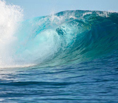 A big wave break spray in the Pacific Ocean.
