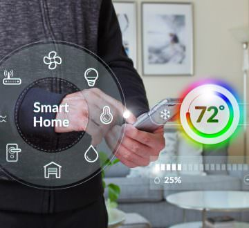 Smart home control dashboard with male using smartphone at home in the background